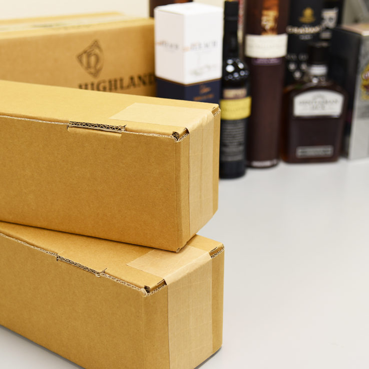 Eco Friendly bottle packaging ready for shipping on packing bench
