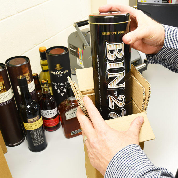 Packing Port Bottle in Outer Tin