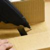 Glue Gun sealing Cardboard Box